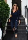 Elizabeth Hurley leaving home with her son in London