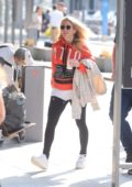 Ellie Goulding spotted in a orange hoodie at the Airport in Krakow, Poland