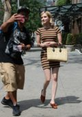 Emma Roberts wearing a Vintage Striped dress while out in Soho in New York