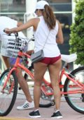 Eva Longoria in Shorts enjoys a bike ride around South Beach in Miami