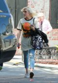 Gwen Stefani makes a stop by a film set to visit Blake Shelton in Los Angeles