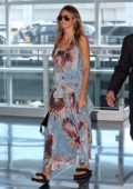 Heidi Klum departs out of JFK Airport in New York wearing a blue summer floral dress while heading back to Los Angeles