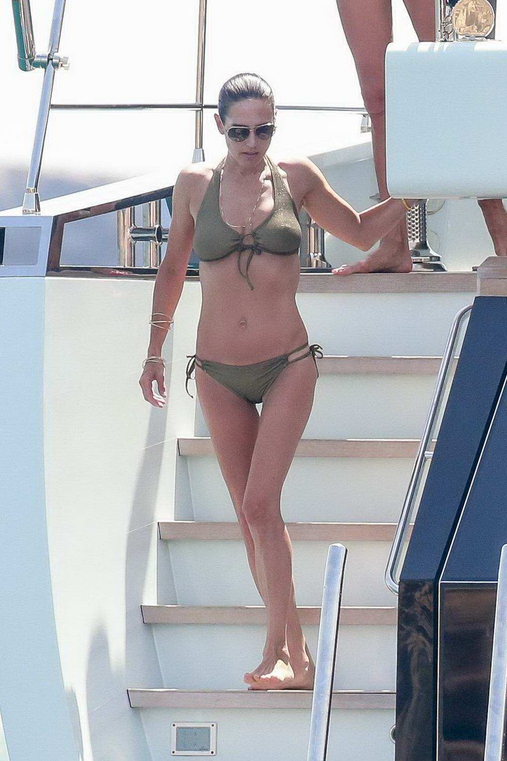 Jennifer Connelly in green bikini spotted on a yacht in Ibiza, Spain