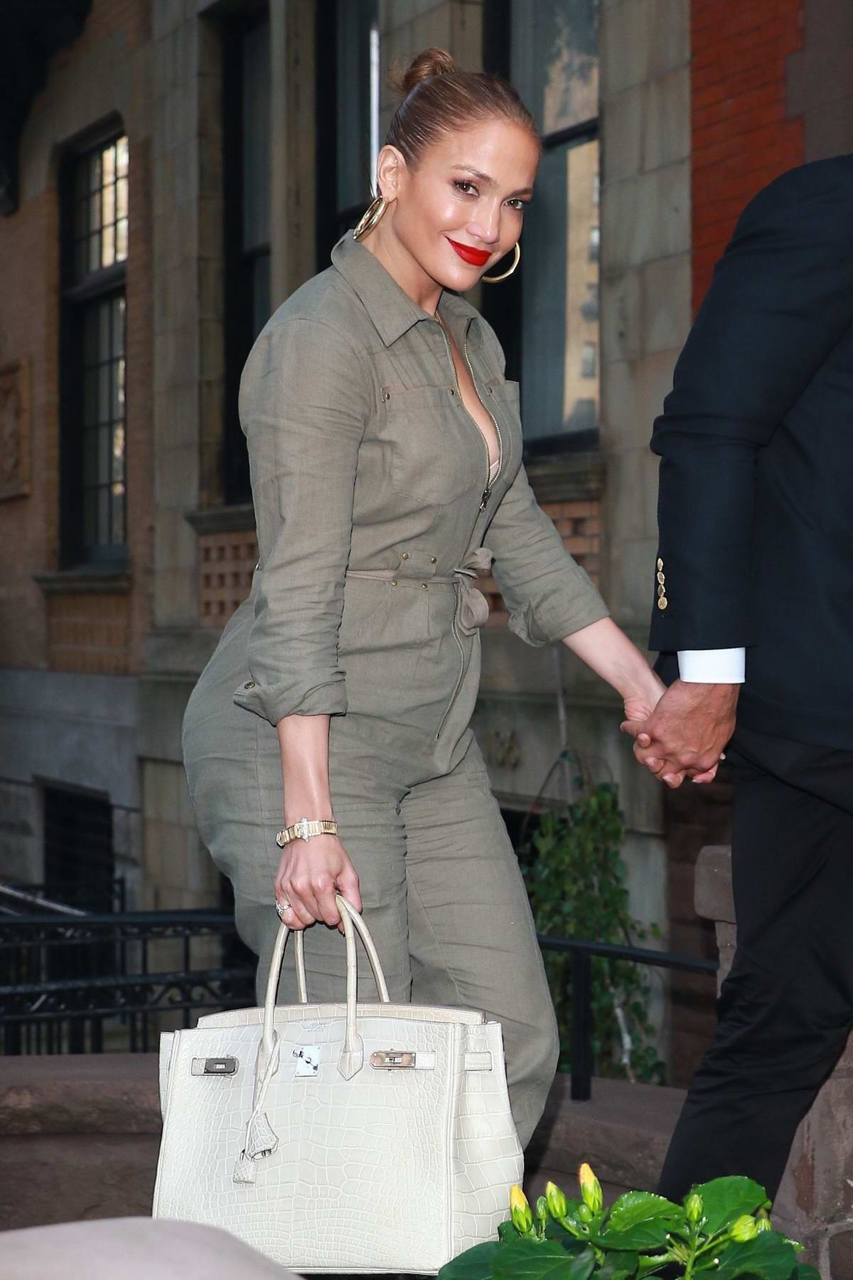 Jennifer Lopez and Alex Rodriguez are all smiles as they arrive for private dinner in New York City