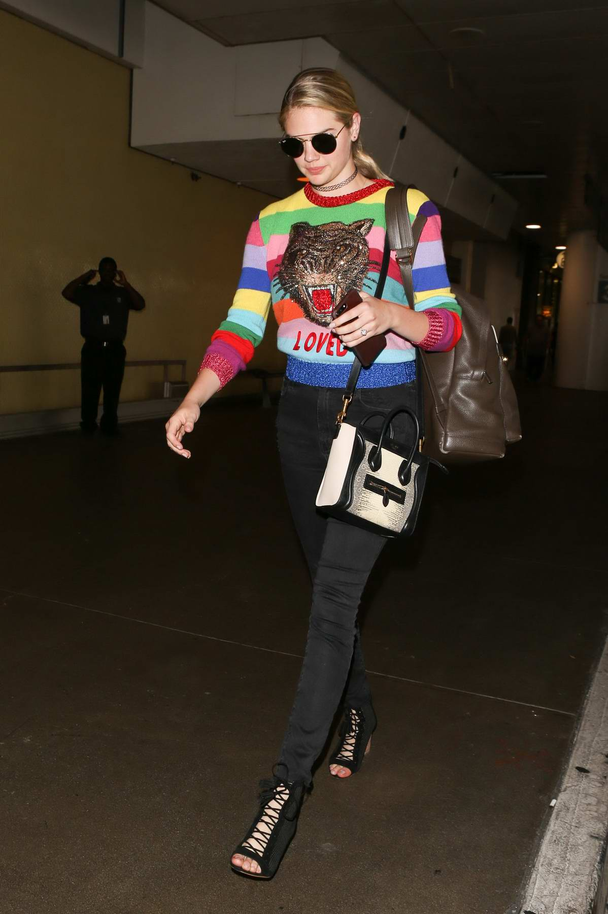 Kate Upton wears colored Gucci sweater upon arrival at LAX Airport in Los Angeles