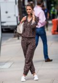 Katie Holmes in leopard print jumpsuit chatting away on her cell phone while shopping on Madison Avenue in New York
