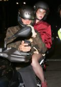 Katy Perry holding onto Orlando Bloom on the back of his Motorcycle heading towards the Staples Center in Los Angeles