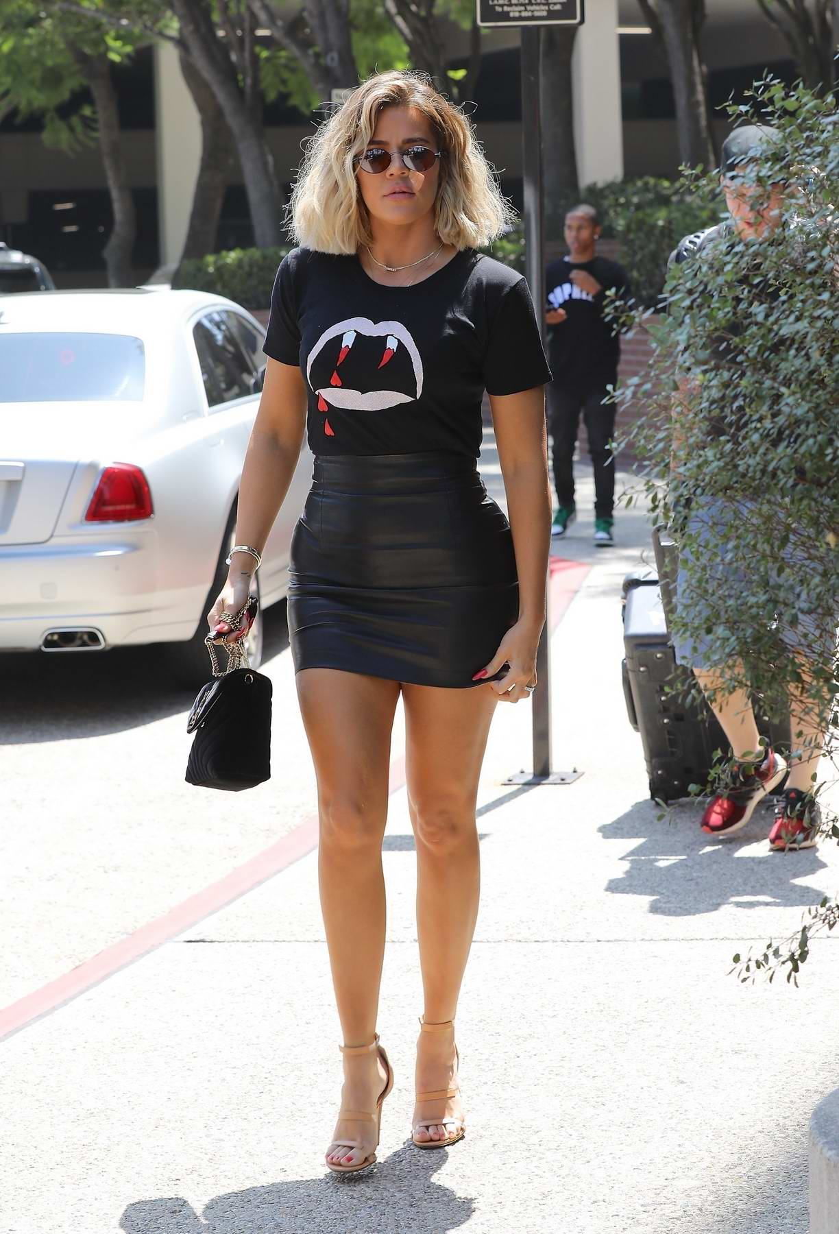 Khloe Kardashian in a black leather dress arrives at lunch in Los Angeles