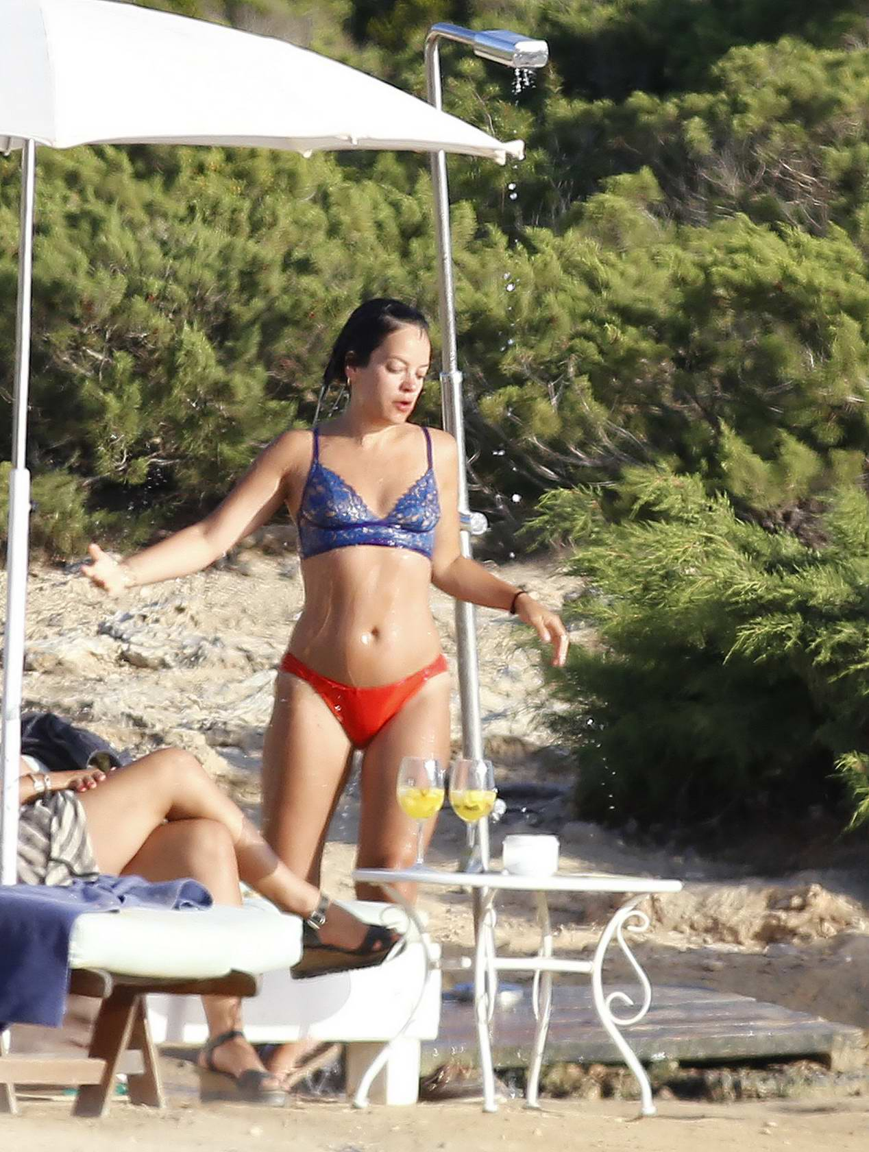 Lily Allen in a red and blue bikini holidaying in Ibiza, Spain