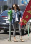 Lily Collins spotted feeding the parking meter as she drops her clothes off to the dry cleaners in Beverly Hills, Los Angeles