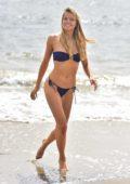 Louisa Warwick in blue bikini on a photoshoot at the beach in Montauk, New York