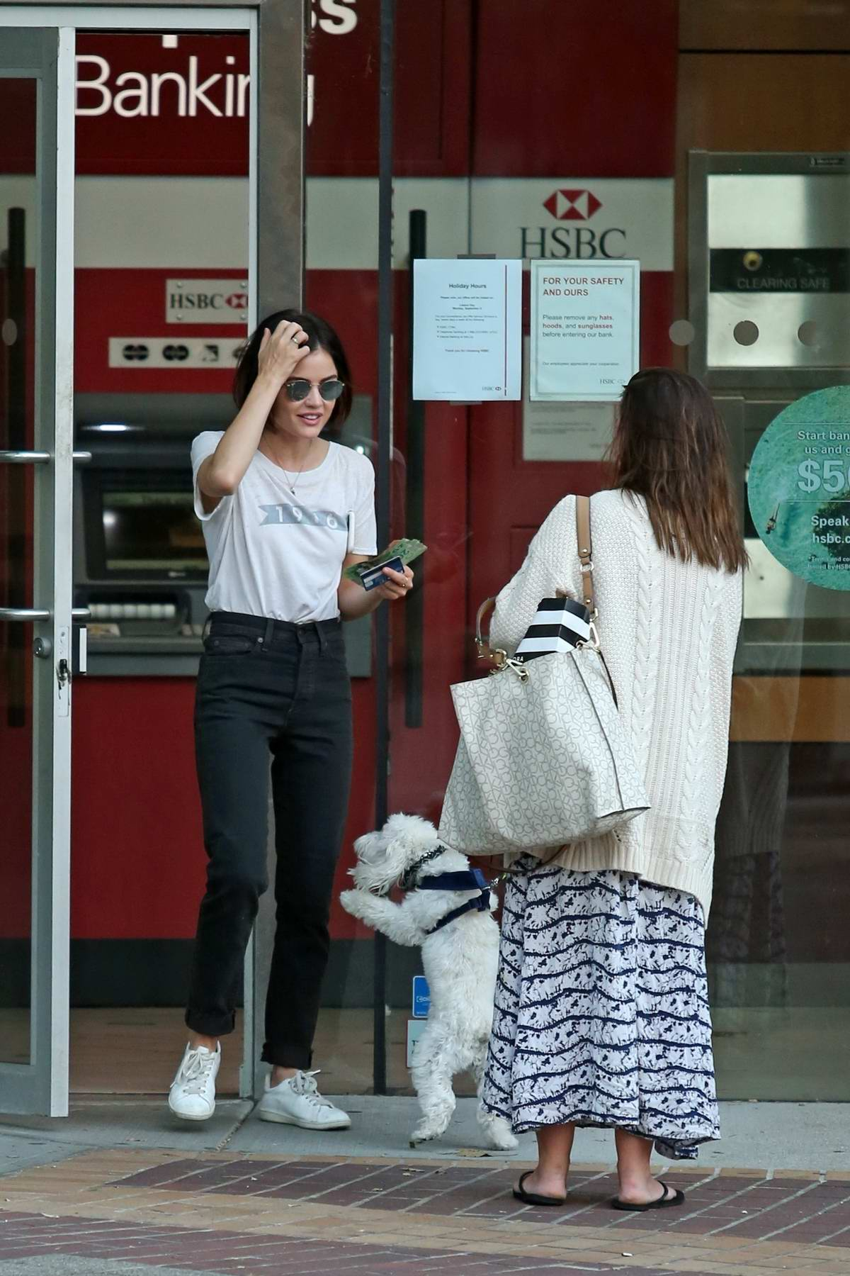 Lucy Hale makes a withdrawal to pay her dog sitter in Vancouver, Canada