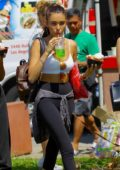 Madison Beer eats a waffle bowl ice cream sundae and lime iced drink at the Melrose Trading Post in Toluca Lake, California