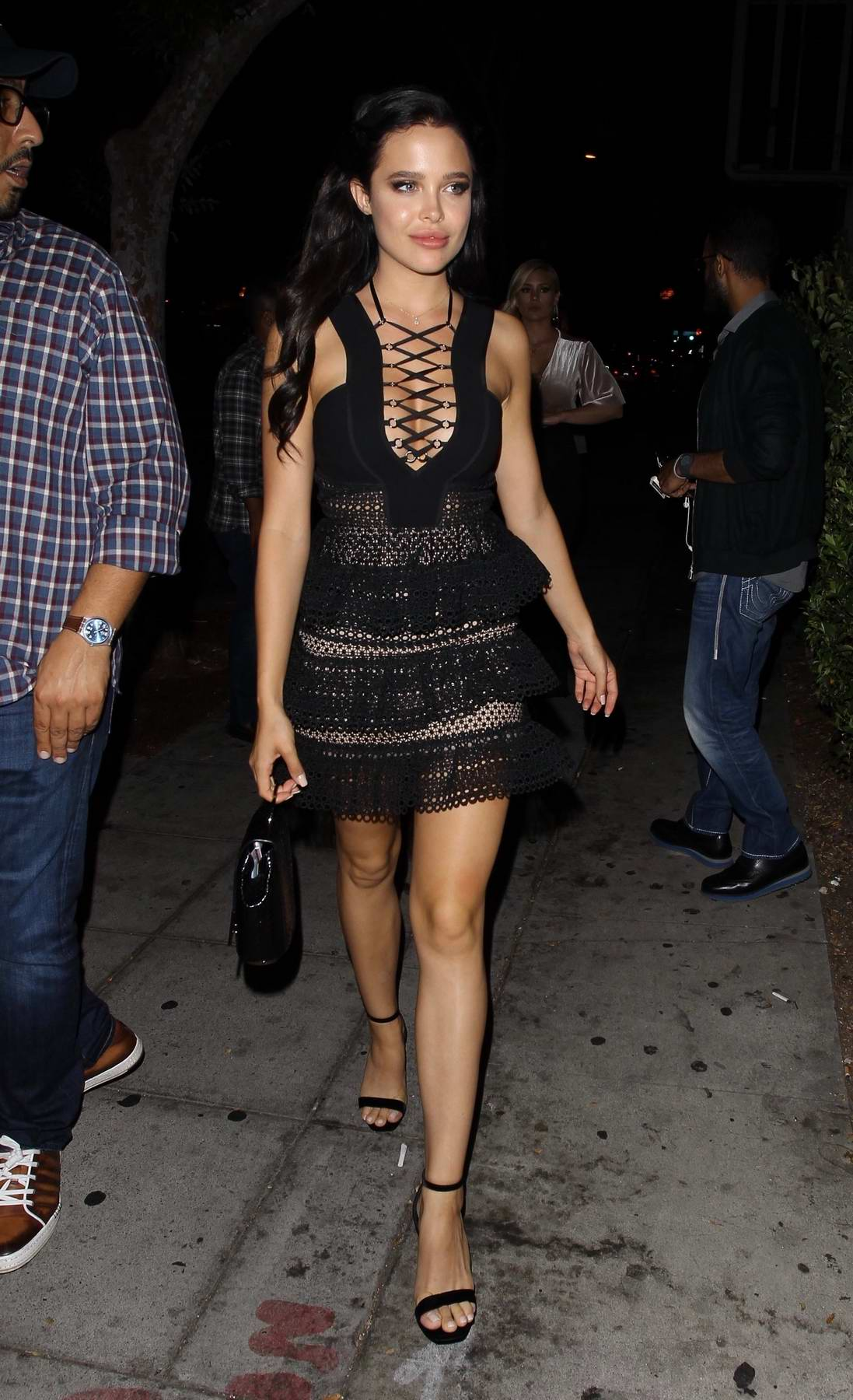 Mara Teigen poses for Photos in a Black Lacy Dress as she arrives at Delilah in West Hollywood