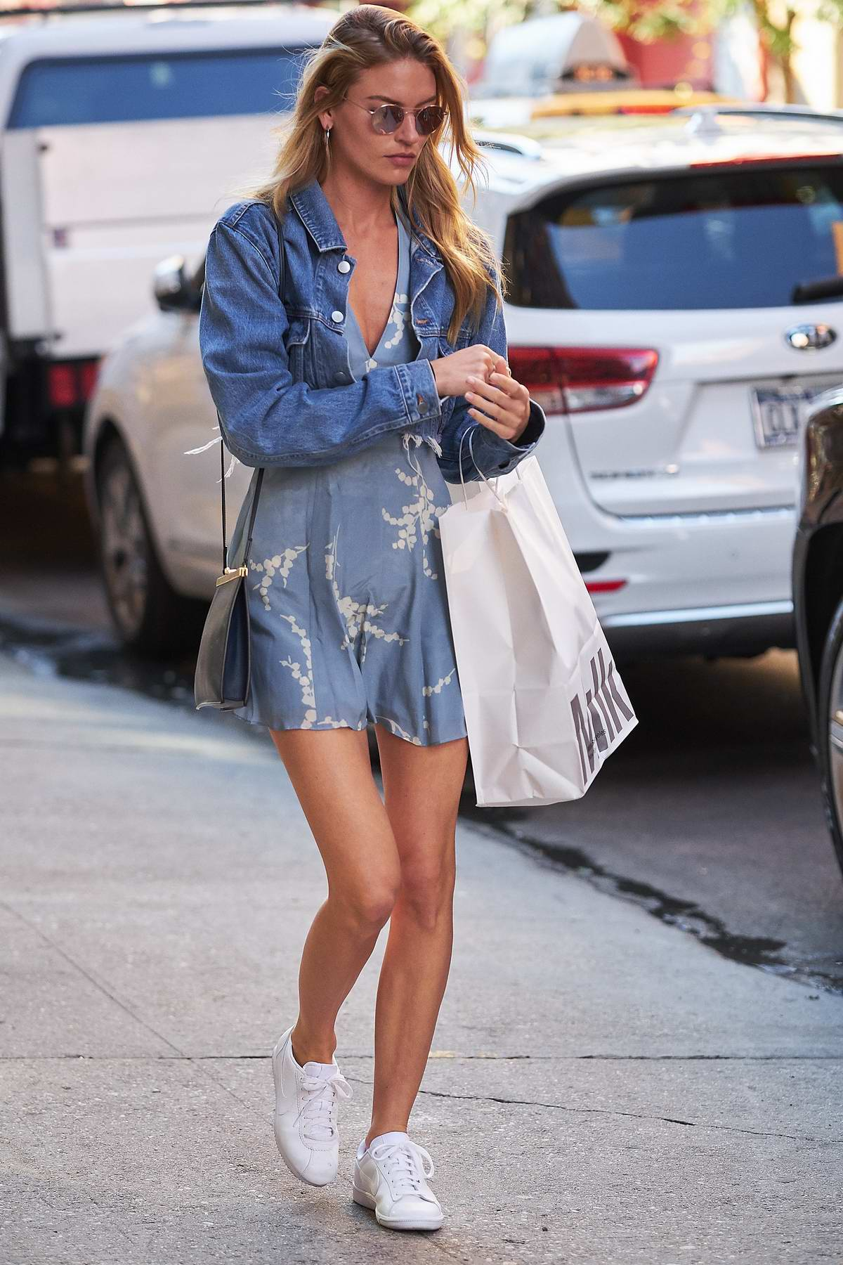 Martha Hunt spotted wearing a blue dress with a denim jacket while out and about in New York