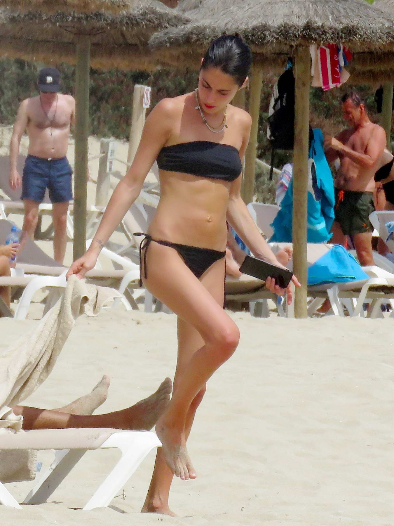 Martina Stoessel in a Black Bikini on a beach holiday with Pepe Barroso in Formentera, Spain