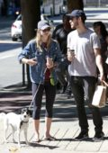 Melissa Benoist and Chris Wood walk their dog on National Dog Day in Vancouver, Canada