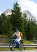 Michelle Hunziker enjoying a bike ride in the Dolomiti mountains in San Cassiano in Badia, Italy