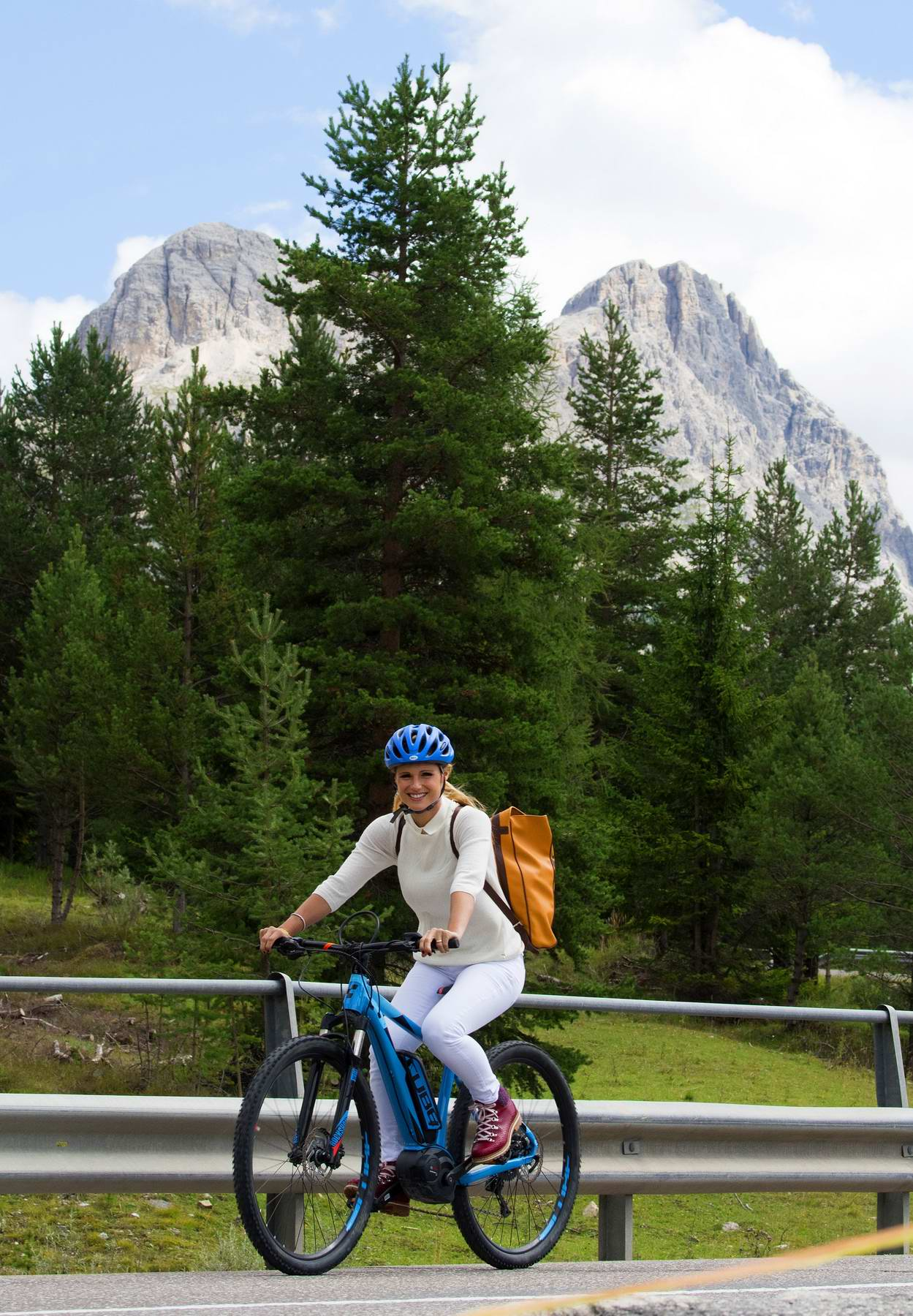 Michelle Hunziker enjoying a bike ride in the Dolomiti mountains in San Cassiano in Badia, Italy
