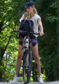 Michelle Hunziker rides a bicycle in Bergamo, Italy