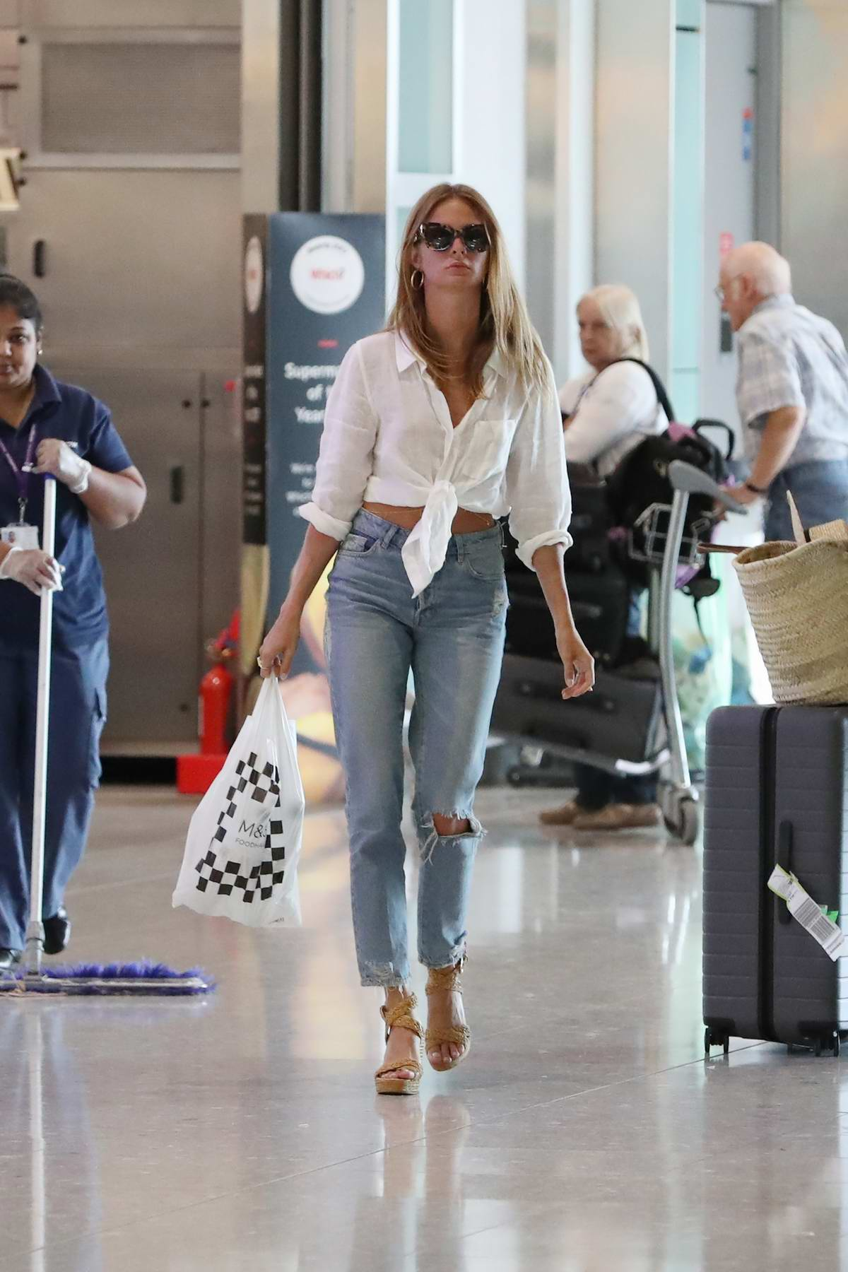 Millie Mackintosh arriving at Heathrow Airport in London