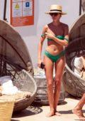 Millie Mackintosh in a Green Bikini relaxing by the pool with boyfriend Hugo Taylor on Mykonos, Greece