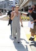 Minka Kelly keeps a relaxed look Pinstriped Overalls while arriving at LAX Airport in Los Angels