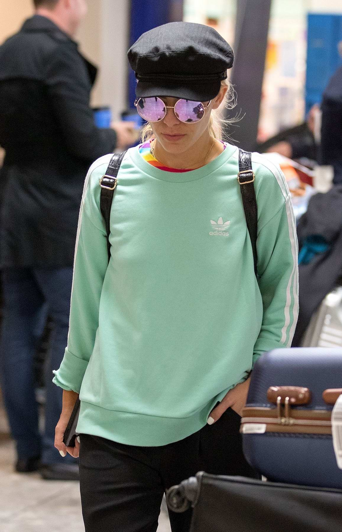Mollie King arriving back from a short trip from Cape Town, South Africa