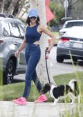 Nina Dobrev wears double denim as she takes her dog for a walk in Los Angeles