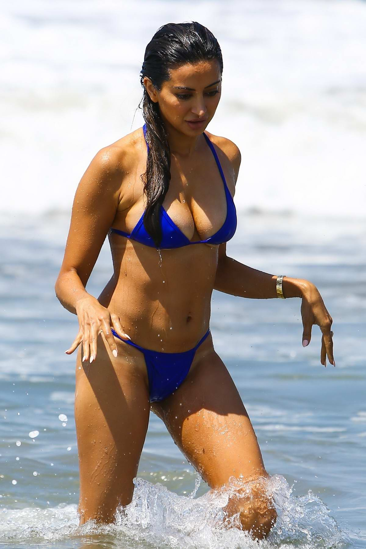 Noureen DeWulf in a Blue Bikini enjoying the Ocean in Santa Monica, California