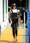Olivia Culpo steps out wearing a pair of Leather Dungarees during a stop off to Bristol Farms in Beverly Hills
