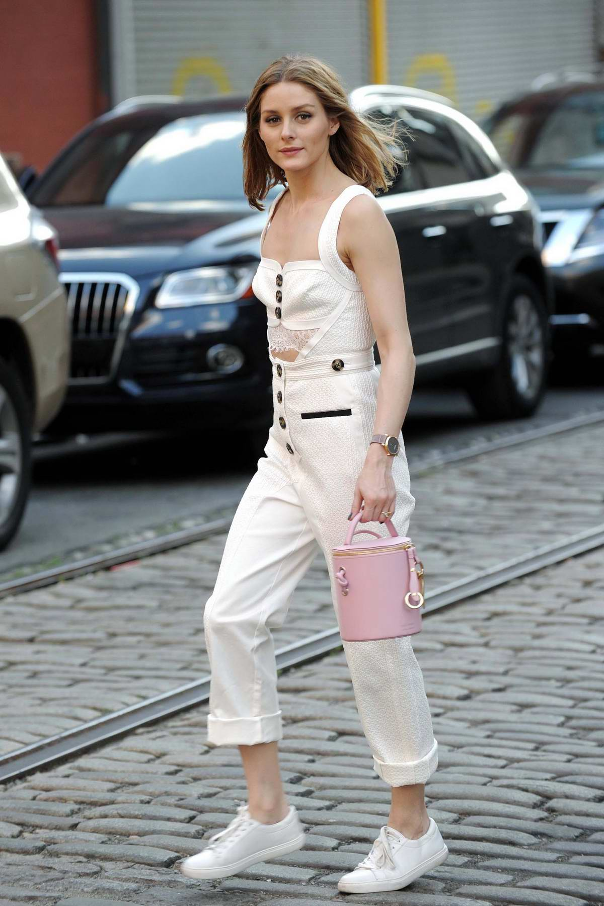Olivia Palermo taking her dog out for a walk in Brooklyn, New York