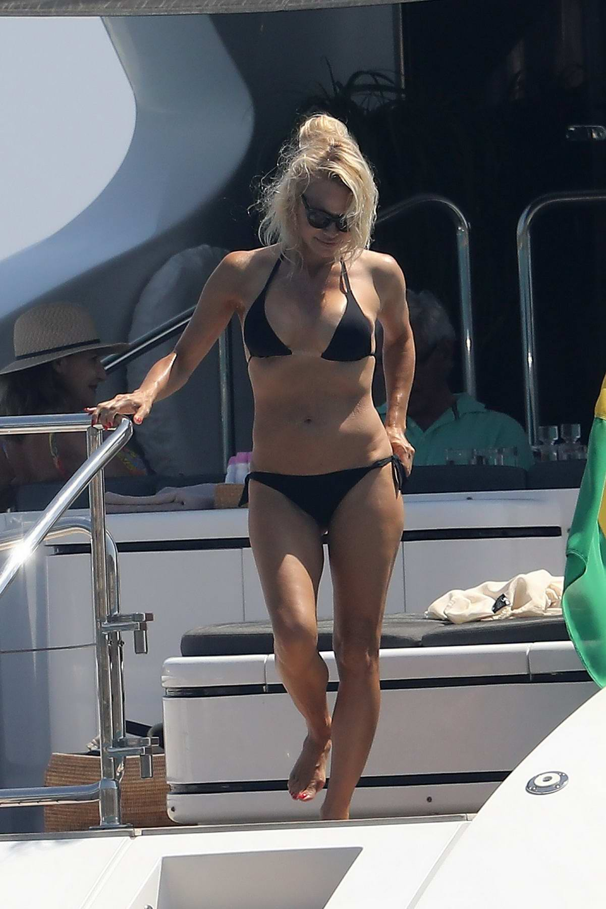 Pamela Anderson in Black Bikini enjoys a swim in the French Riviera, France