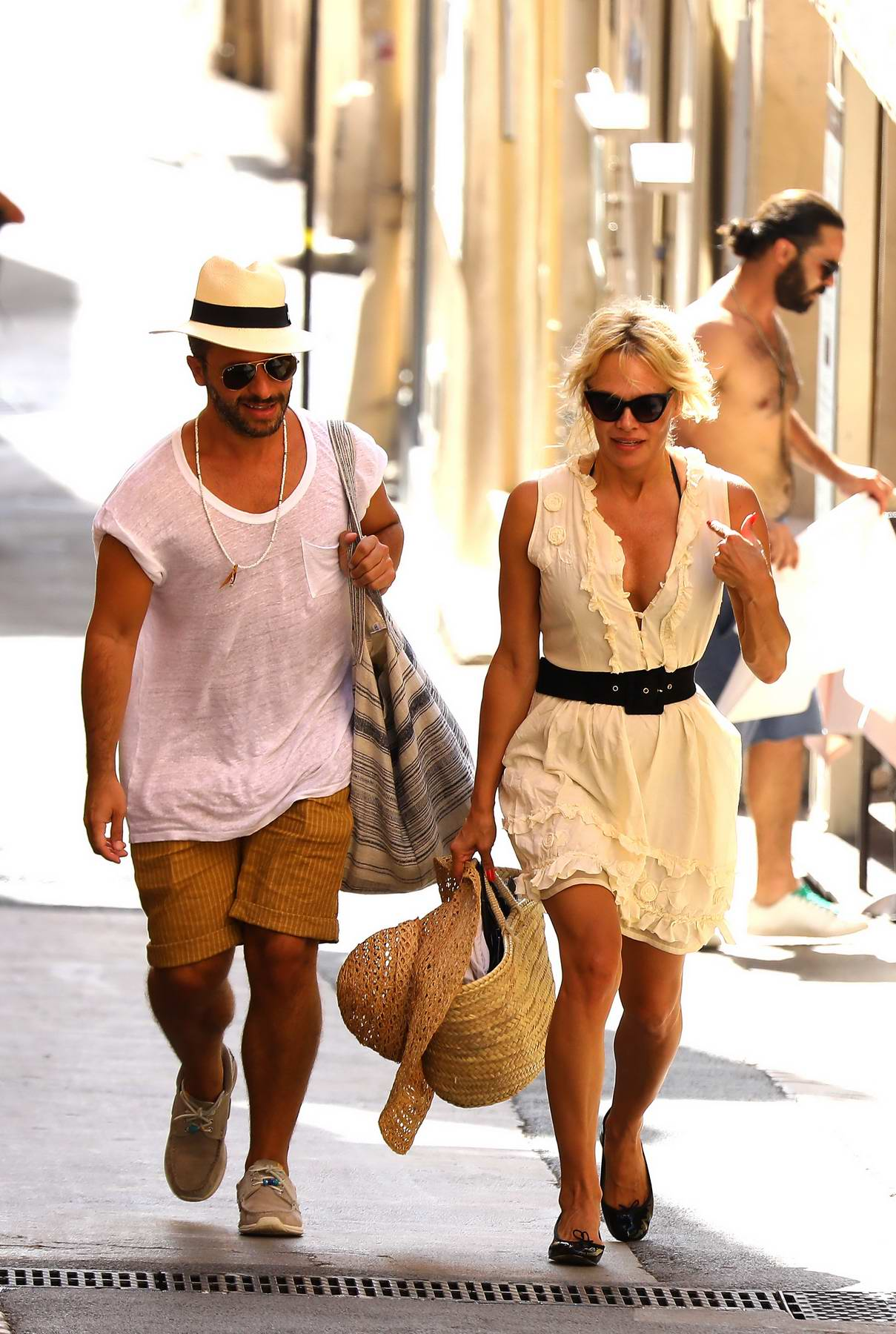 Pamela Anderson spotted with a Male companion strolling through the Old city streets in Saint Tropez, France