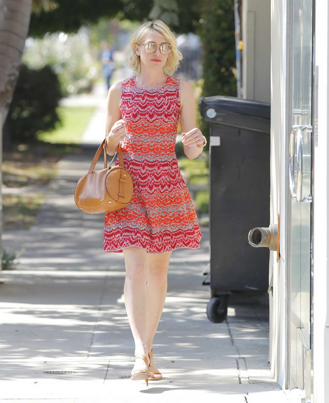 Portia de Rossi in a short red dress running errands in West Hollywood, Los Angeles