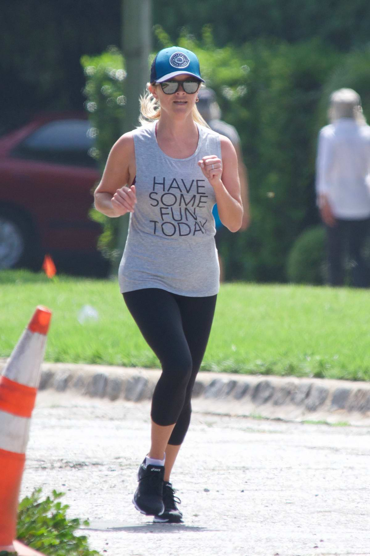 Reese Witherspoon jogging around her neighborhood in Brentwood, Los Angeles