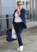Reese Witherspoon shows off a new short haircut at JFK Airport in New York