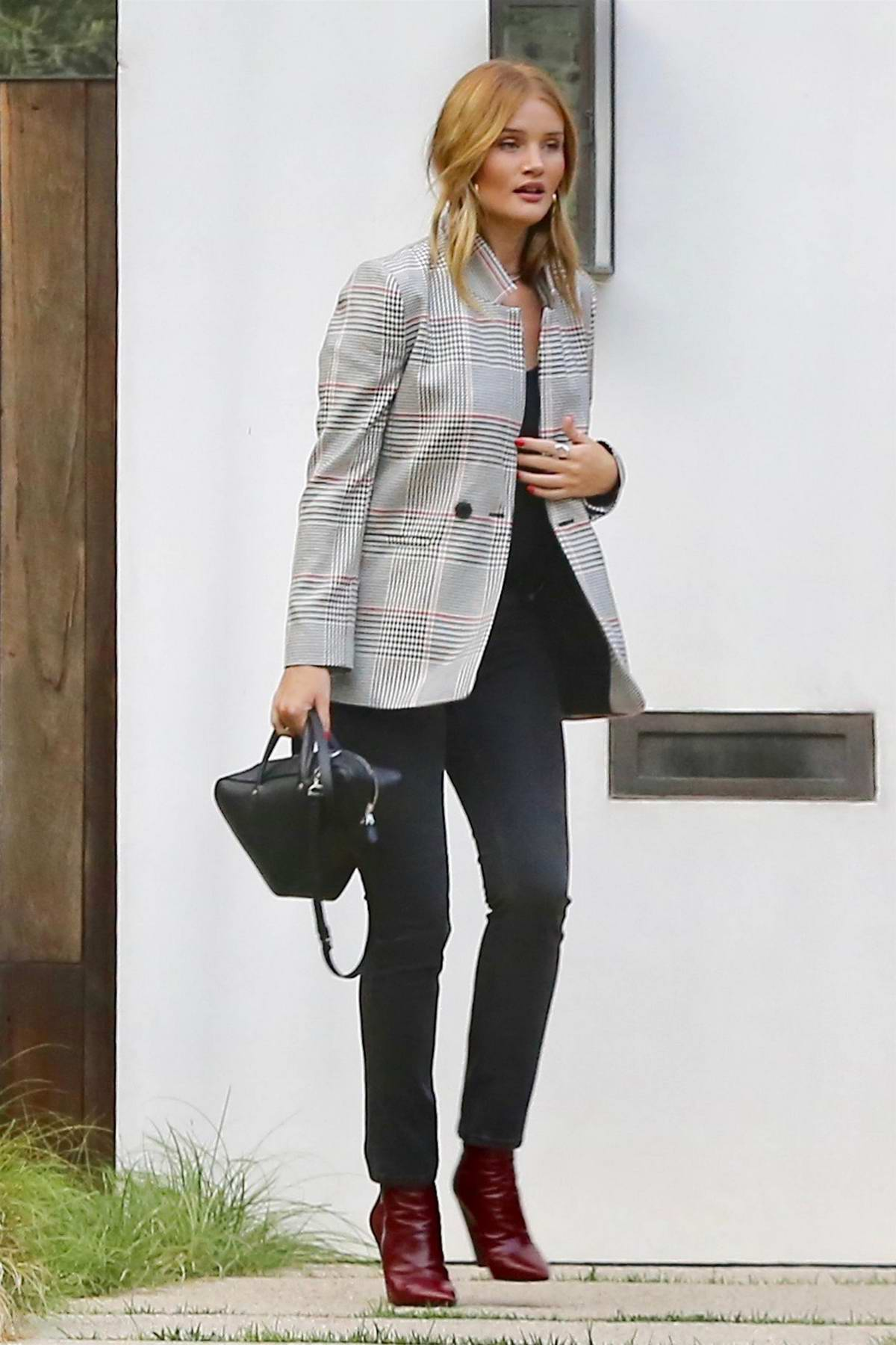 Rosie Huntington-Whiteley spotted arriving at a party with a Friend in Hollywood, Los Angeles
