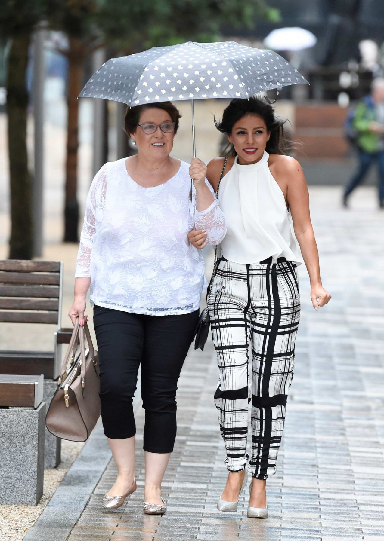 Roxanne Pallett gets caught in the rain as she arrives with Mother at Laundrette Bar and Restaurant in Manchester, UK