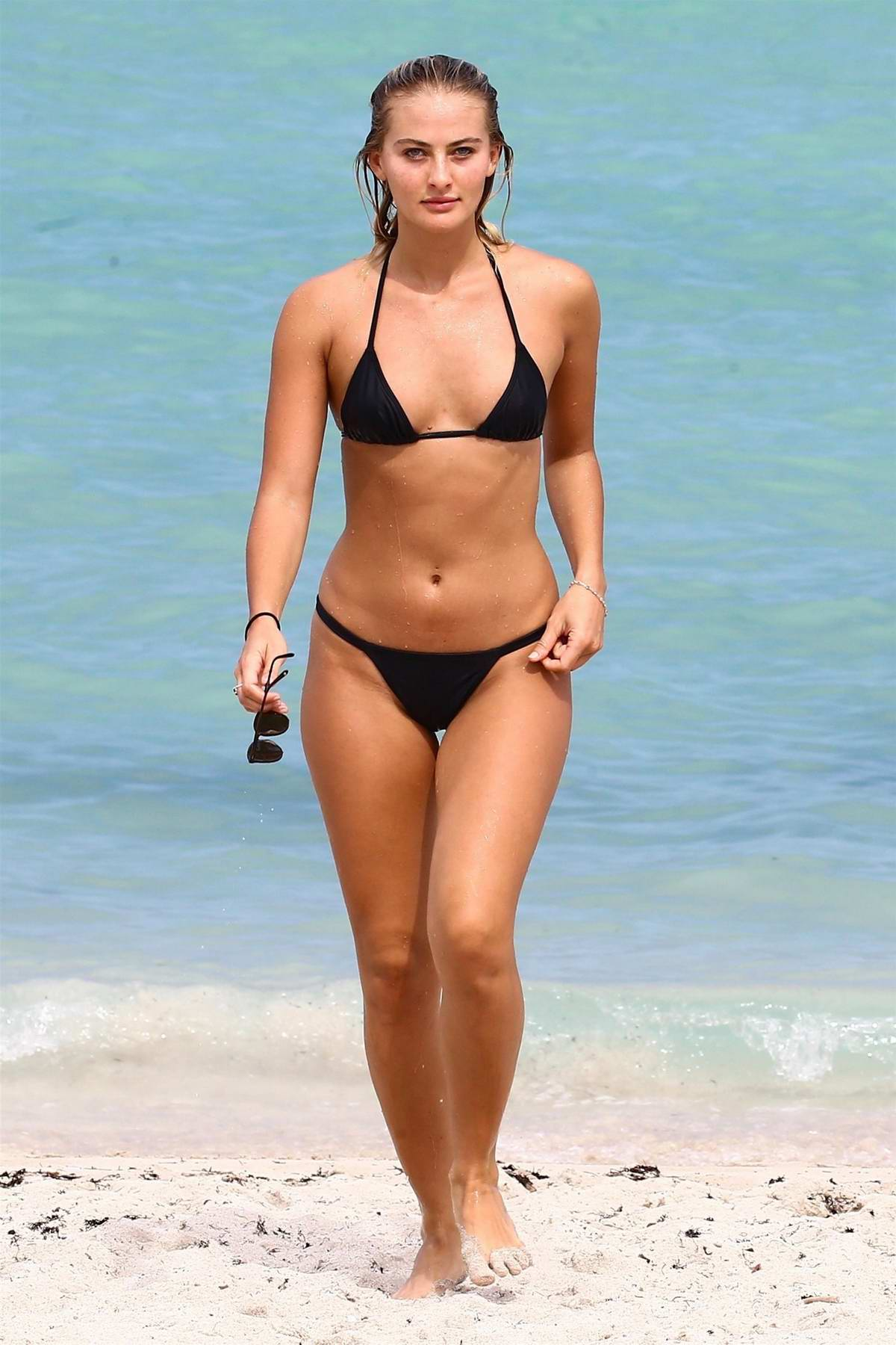 Selena Weber in a Black Bikini enjoying the Ocean in Miami