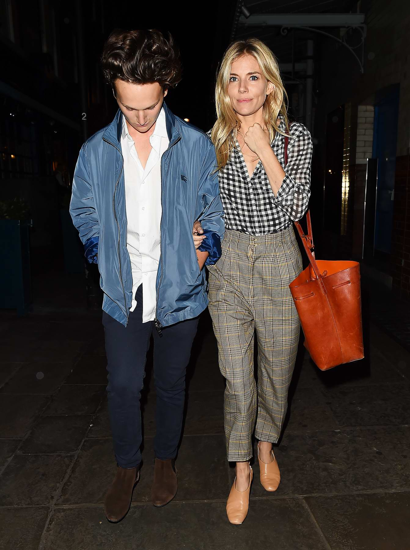 Sienna Miller leaves J Sheekey Restaurant with male friend in Covent Garden, London