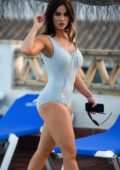 Vicky Pattison in a swimsuit relaxing by the poolside with her boyfriend in Marbella, Spain