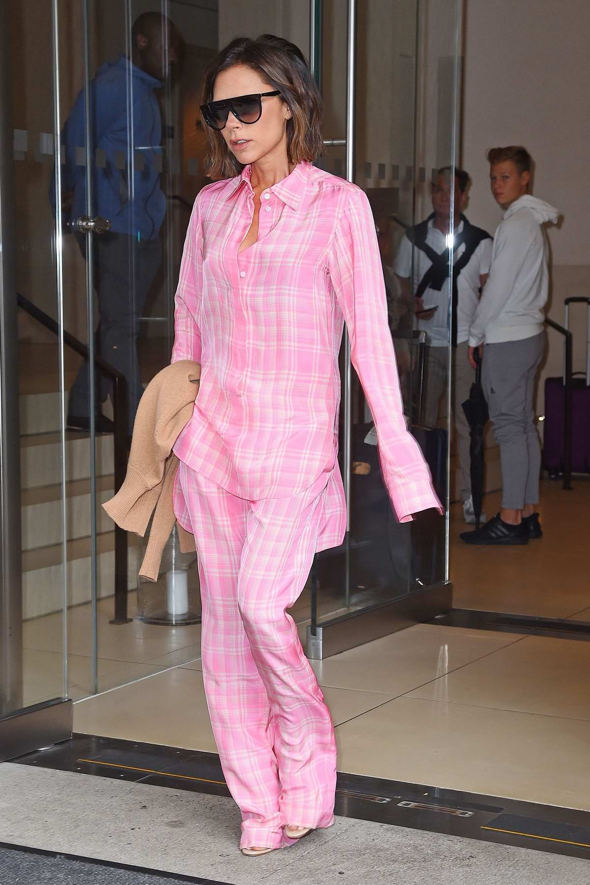 Victoria Beckham dressed in pink plaid leaving her hotel in New York City