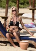 Victoria Silvstedt in Bikini enjoys a day at the Beach with boyfriend Maurice Dabbah in Cala di Volpe, Italy