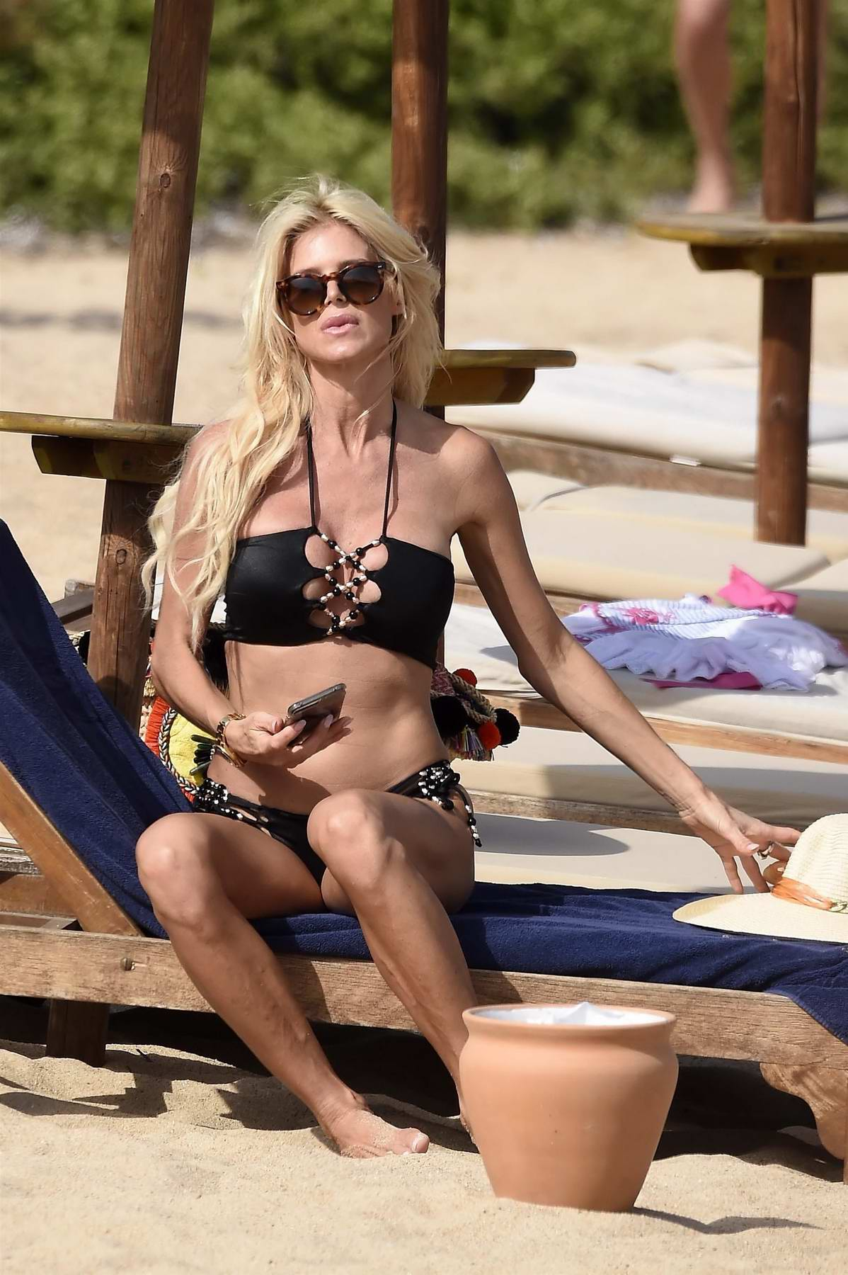 Victoria Silvstedt in Bikini enjoy a day at the Beach with boyfriend Maurice Dabbah in Cala di Volpe, Italy