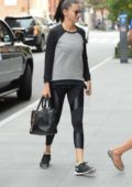 Adriana Lima arriving at an office building in New York City