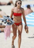 Amy Pejkovic in a red bikini on the beach in Sydney, Australia