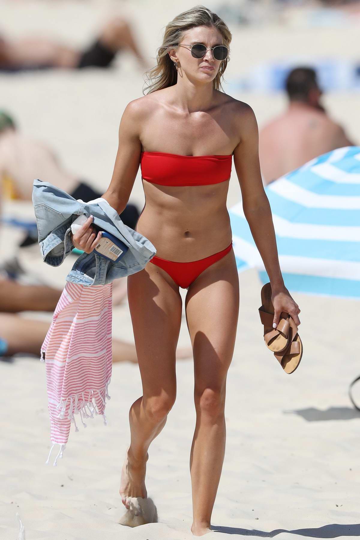 Amy Pejkovic in a red bikini on the beach in Sydney, Australia