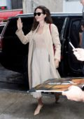 Angelina Jolie greets her fans while she arrives at an office building in New York City