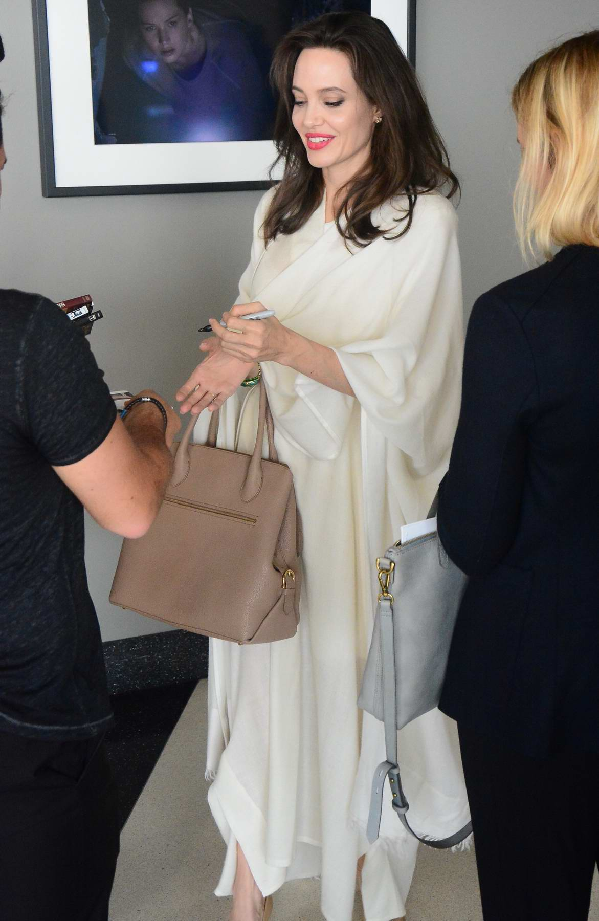 Angelina Jolie in all white arriving to movie Q and A in Los Angeles